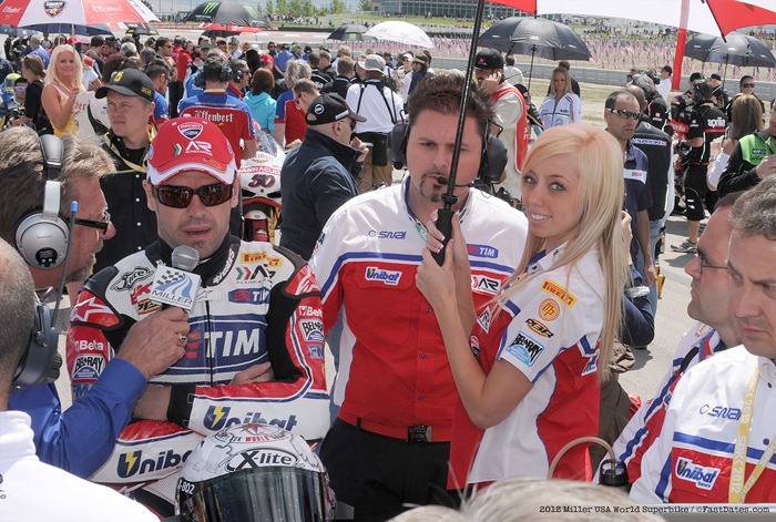 Caitlyn Christianson and Carlos Check on the start grid at Miller World Superbike
