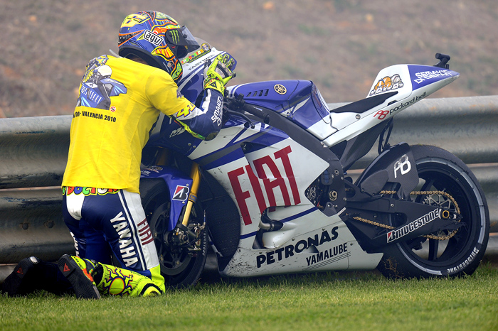 Valentino Rossi says goodbye to his Yamaha M1 motoGP bike at Valencia