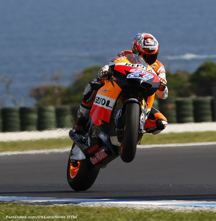 Casey Stoner Phillip Island MotoGP action wheelie photo