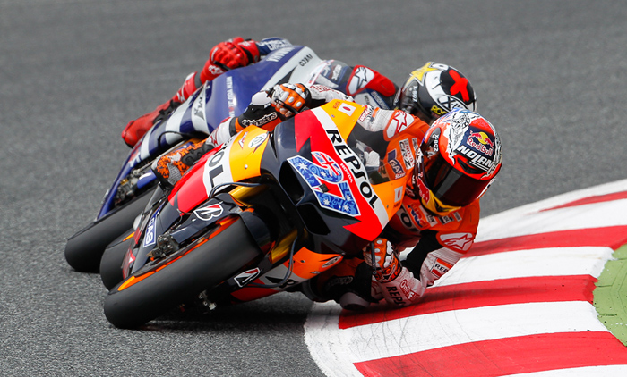 Casey Stoner, Jorge Lorenzo Catalunya MotoGP action photo