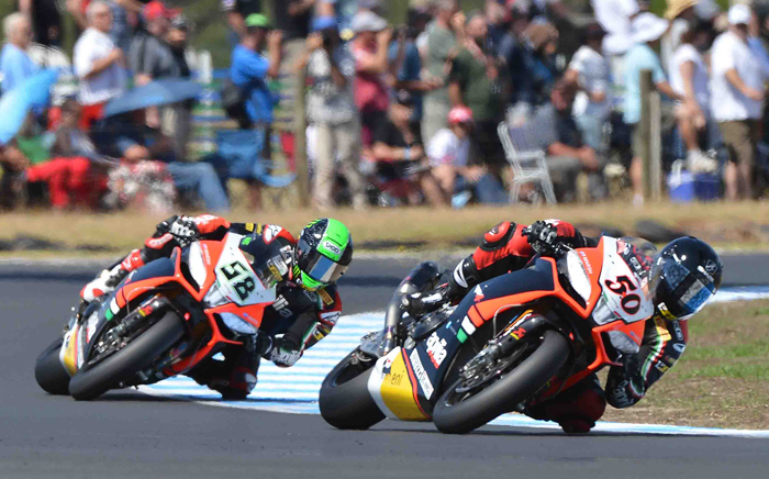 Guintoli Laverty race action photo