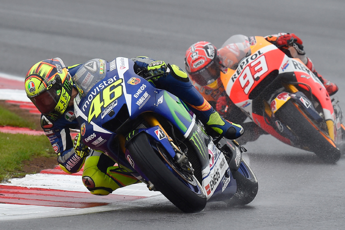Rossi Marquez Silversone 215 motoGP race action photo